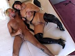 Kinky brunette milf, wearing fishnets, shows her big natural tits to a guy and lets him lick her twat. After that they have sex in the cowgirl position.