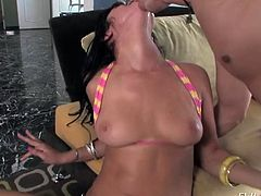 Make sure you take a look at Sadie West's amazing body in this hot scene where this sexy brunette fucks a guy with a strapon.