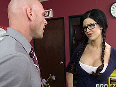 Hot college girl Kendall Karson, wearing a miniskirt and glasses, seduces Johnny Sins and gets naughty with him indoors. They lick each other's privates ardently, then fuck doggy style and Kendall gets cum on her big fake tits.