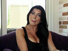 Extremely hot brunette with big fake tits Romi Rain kneels down and gives deepthroat blowjob