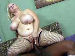 Charming BBW in fishnets oils her natural tits before giving her dude a nice titjob and getting hammered hardcore missionary