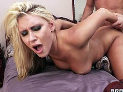 Take a look at this hardcore scene where the slutty blonde Katie Summers sucks on this guy's big cock before being fucked up her ass.