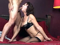 Dark haired mature doll with big natural tits in miniskirt unpins her attire before swallowing a heavy dick till the he cums in her mouth