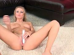 Blonde Natalia Starr masturbates with a toy