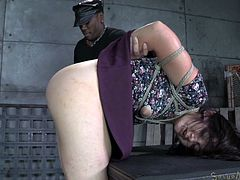 Her dress is hiked up and she is tied up in rope. She's bent over the chair. First she is face fucked by her white master, and then her black master pounds her hard from behind. The masters team up and fuck her at the same time. She chokes on black dick and gets fucked from behind by white cock.