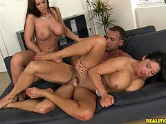Cute cowgirl with fake tits in bikini gives a horny guys a handjob then gets her shaved pussy feasted mercilessly in a threesome