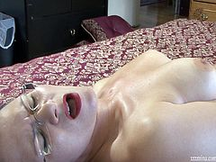 Watch this hot solo scene where the horny milf Mina Gorey masturbates with a dildo as you hear her moans and watch her wear stockings.