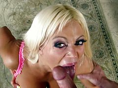 Busty blond mom Nikita Von James, wearing lingerie, shows her big boobs to a dude and turns him on. Then she kneels in front of the guy and works on his boner.