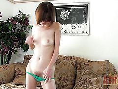 Brunette gal Jay Taylor with tiny tities takes toy up her beaver after sexy striptease