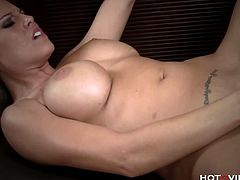 Big tits whore Charisma Cappelli masturbates naked. She sucks her big tits and tickles her nipples with her vibrating sex toy before attaching the slimy toy for supreme fun.