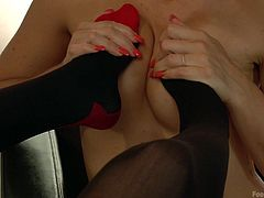 These blonde lesbians have a fascination with each other's toes. Aiden sticks her nylon covered feet in her lover's face and rubs them on her amazing titties. The stockings come off and Dylan starts to lick and suck those sexy feet.