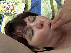 This mature redhead slut pulls down her man's pants and begins sucking him off right there in the open. She puts her legs behind her head so that he can fuck her pussy hole. The guy makes the mature slut taste his fingers that are covered in her pussy juice.