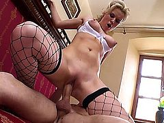 Syren Sexton looks fabulous wearing her business uniform with fishnets stockings, while she's laying back on the couch with her legs open, getting her mostly shaved, blonde pussy fingered and penetrated by her lover, who then nails her from behind before he gets a blowjob, while you see her big tits swing, until she gets a creampie.