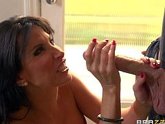 Lezley has been waiting all afternoon, when the long expected guest knocked at her door. The black-haired milf put on her most beautiful dress and stockings. Alone with the young stud, the slutty lady undressed right away and unziped the guy's pants to suck his big cock standing on knees on the floor. Enjoy!