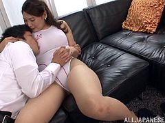 Hot Japanese Cowgirl with Natural Tits and in Pantyhose sits on the couch as she touched her Tits her guy shows up and bang her cunt Doggystyle
