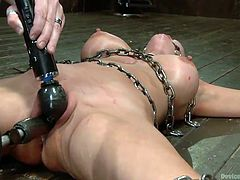 Down in the basement, a merciless executor begins his sadistic plan. A tied up blonde slut has to try out the bondage device. While her pussy's stimulated with the help of a vibrator, she's wearing a ball gag. Click to see the kinky helpless bitch with small tits tortured for pleasure.