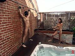 Lexi is a mean hottie and loves to give men some real pain. The beauty is completely naked and looking so hot in combination with her dirty mind makes her really sexy. The bitch tied this dude on the wall, gave him a shower and then putted him in the bath tub and made him lick her feet. Oh yeah!