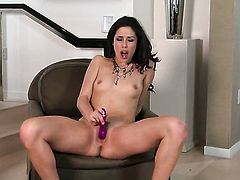 Anna Morna with tiny tits and trimmed twat does striptease before she sticks vibrator in her pussy