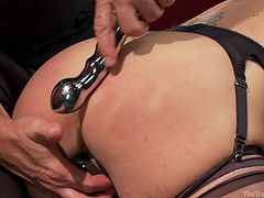 this dirty slut must suck on the gimp's cock while the dominant master gets her off. She will only be rewarded with an orgasm is her cock sucking skills are good enough. He has a dildo in her but and a vibrator firmly pressed against her clit.
