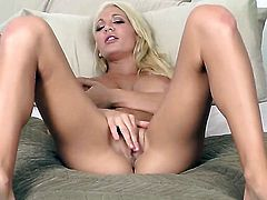 Devon Alexis with massive melons and hairless twat satisfies herself in solo action