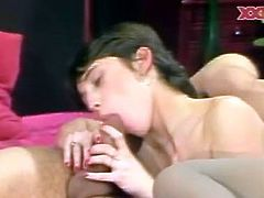 Classic brunette chick in stockings sucking big meaty cock