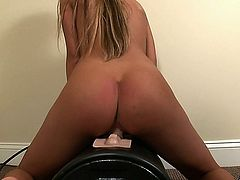 Beautiful August Ames rides sex machine untill she squirts