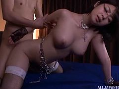 Tantalizing Asian cowgirl in stockings and sexy thong thrilled as her big tits are sucked then bends over and gets drilled doggystyle