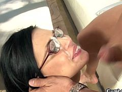 Watch this sexy big titted porn-star Eva Angelina in this hot blowjob video, where she sits on her knees and licks her lovers big balls and sucks his dick deep and hard till he shoots his cum on her pretty face and the glasses that she had on.