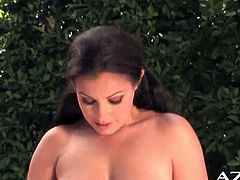 Aria Giovanni is a hot and alluring brunette goddess ready to flaunt her hot body in the backyard while assuming very naughty poses.