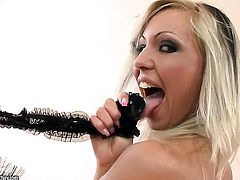 Blonde Adriana Russo with big jugs finds herself horny and takes toy in her pussy hole