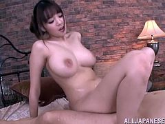 Delectable Asian cowgirl with big natural tits getting her hairy pussy slammed missionary hardcore then gives an oily tit fuck