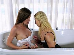 A horny couple has chosen to spend a relaxation time in the bath tub. The blonde and the brunette hot lesbians remove their sexy lingeries and begin exploring their slim bodies. Click to see them caressing, kissing, sucking tits, licking pussy and fingering each other with sheer passion. Details are amazing!