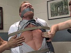A guy finds himself completely helpless as two angry horny cocks have tied him up in a fierce rope bondage and have also mouth gagged him. Watch the tattooed man sucking nipples and performing a passionate and intense blowjob. The atmosphere gets even hotter as the dirty game is completed by vibrators.