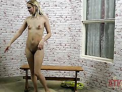 Blonde exotic woman with small tities and smooth beaver touches her neat snatch after posing naked