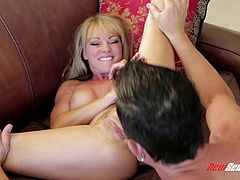 Check out this amazing hardcore scene where the cock thirsty blonde milf Shayla Laveaux is fucked by a large cock after sucking on it.
