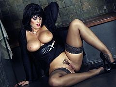 Brunette solo model with big tits in leather and alluring black lingerie with stockings enjoys masturbation with finger fucking