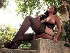Beautiful solo model brunette in nylon stocking stripteases seductively while displaying her hot ass in a reality shoot outdoor