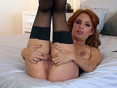 Erotic redhead babe in nylon stocking and lingerie shows her asshole and cunt before fingering wet beaver in masturbation