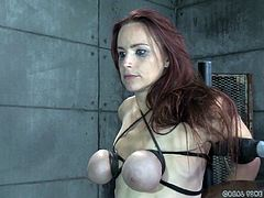 This redhead slut has ropes tightly wrapped around her boobs as she is tied up. Watch as she is brought down to her knees and fucked in the mouth by her master. His cock is being slapped on her face and her boobs are almost turning blue.