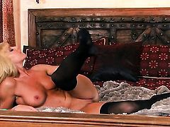 Niki Young with shaved twat spends her sexual energy alone with the help of vibrator