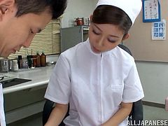 Captivating Asian nurse in nylon stocking enjoys her hairy pussy being licked immensely before awarding her guy a superb handjob