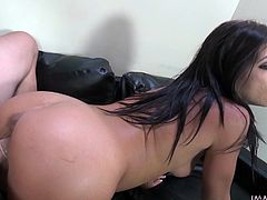 Take a look at this hot chick. She is ready to play a game. The wheel gets spinned and she has to get on her knees and give this guy a nice, wet blowjob. She slobbers all over his cock, and then takes it in her cunt from behind.