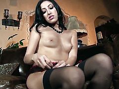 Kimberly Gates has fire in her eyes as she toy fucks her hole