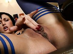 Roxanne Milana with giant boobs and bald cunt touches her moist muff pie in solo scene