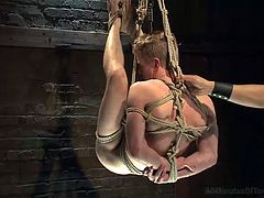 Gay boy Liam has a very tight anus, so tight that his executor's cock barely fits inside it, but it fits in the end! He's tied up, hanged and fed with cock until his master decides it's time for the real fun. So, he spins him around and then shoves his penis in his tight, shaved anus making the boy toy scream
