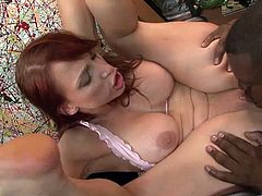 Tantalizing redhead with big tits in thong giving an impassioned blowjob then gets her shaved pussy licked before getting romped missionary style