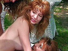 Lucky dick pampered by two redheads