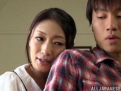 japanese cowgirl with long hair seduces young guy kiss nicely then gives awesome handjob to him in a clothed sex hardcore