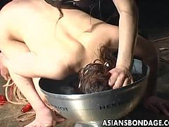 The mean Japanese mistress has the slave tied up in rope bondage, but she starts off with a little pleasure. The slave has a tiny vibrator caressed against her pussy and nipples by the master. Next comes the pain. He slave has her head dunked underwater and each time she comes up for air, she is gasping.