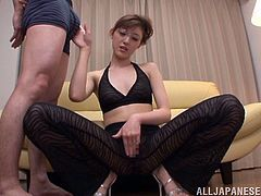 Captivating Asian cowgirl with natural tits in glasses takes a closer look of a huge dick before awarding him a superb blowjob